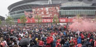 fans gather outside Emirates protest for Stan Kroenke out